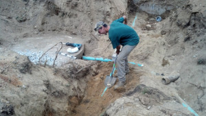 Man working on septic tank repair